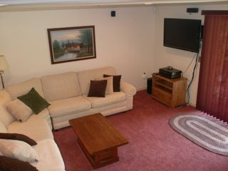 North Conway condo photo - Seating area walk out lower level, TV with surround sound, desk.