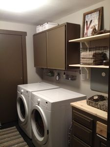 Laundry Room with Washer, Dryer and extra Refrigerator