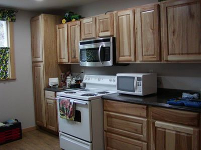 Big Arm house rental - guest cabin kitchen