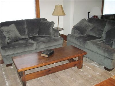 Cozy loveseats in TV area....full sized sofa/loveseat in living area.
