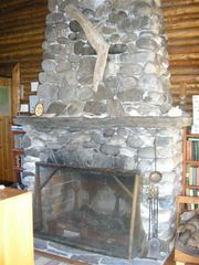 Pemaquid Point cottage photo - Stone Fireplace in Dining Living Area