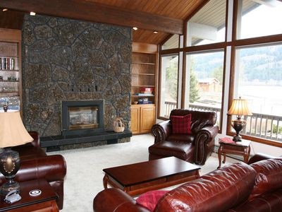 Upstairs Living Room with Large Bay Windows looking onto Lake
