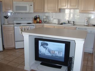 Port St. Lucie condo photo - From the living room looking into the kitchen. Note HDTV with DVD player