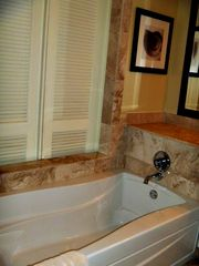 Dunmore Town condo photo - Bath tub shown with sliding doors to bedroom closed