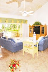 Grand Cayman condo photo - Spacious living room enhanced by cathedral ceiling