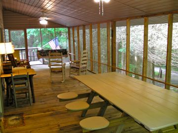 Huge screened in porch with porch swing, ceiling fans & plenty of room for all!