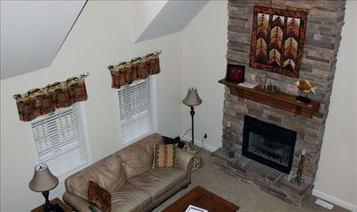 Living room with cozy fireplace and handmade quilt