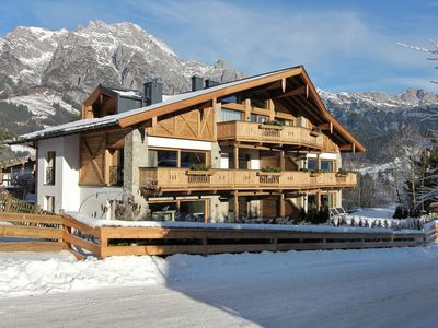 Luxury lodge decorated with beautiful wood accents near the lift