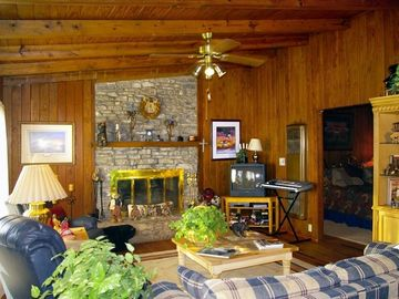 Comfortable, warm rustic cottage has a fireplace, recliners and cozy sofabed.