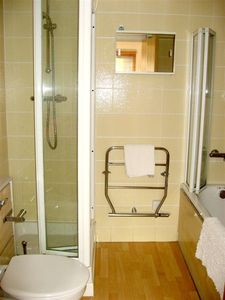 Ensuite bathroom with power shower and bath tub