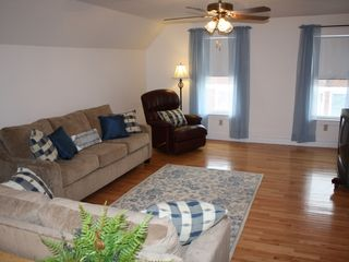 York Beach apartment photo - Spacious Living Room with plentiful sunlight calls for enjoyment
