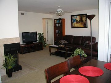 Oro Valley condo rental - dining & family room with fireplace and double size windows.