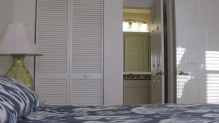 Sanibel Island condo photo - guest bedroom with walk through to private bath