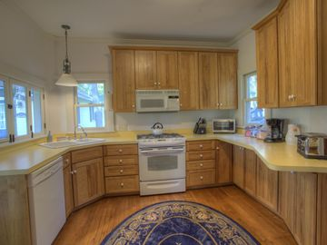 The updated kitchen with gas range, adjacent to the screen porch and Dining Room
