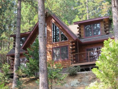 The cabin sits just inside Tahoe National Forest with panoramic views.