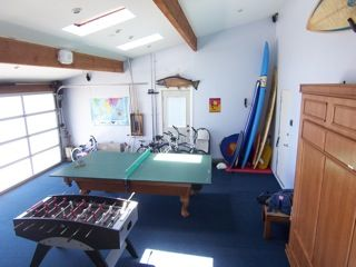 GAME ROOM PING PONG FOOSBALL BIKES ETC