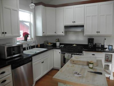 Gourmet Kitchen-stainless steel appliances, granite, and gas stove