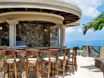 Pool Deck Bar and Grill with views over Cinnamon Bay to Jost Van Dyke