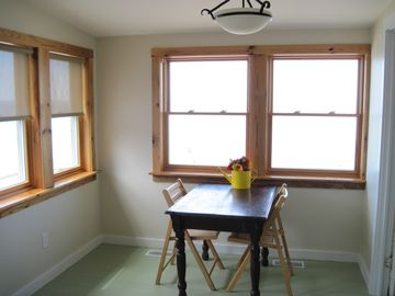 Breakfast nook looks out over the beach and lovely Lake Michigan.