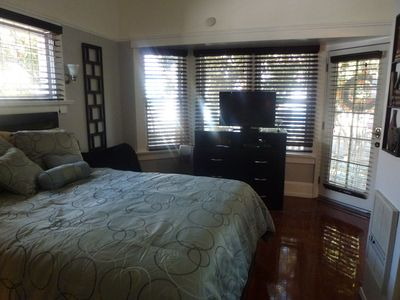 Studio with luxury bed, dresser, & flat screen, high definition TV.