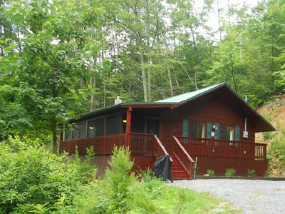 Luxury Wears Valley rental-cabin with carpeted screened-in porch, and hot tub.