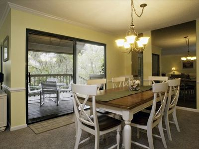 Beautiful dining room with seating for eight and overlooks outside deck