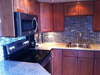 Custom kitchen with granite counters and stainless steel appliances