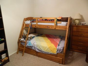 Upper floor bedroom. Double and single bunks, two dressors.