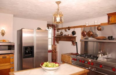 Full service kitchen w/ copper sink & brick floor ... perfect for gourmet meals