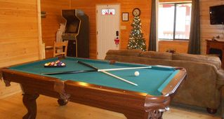 Pigeon Forge cabin photo - Games include pool table, foosball, video arcade, etc. Blu-ray player & DVDs too