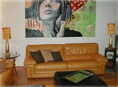 Living room with leather sofas and original art work!