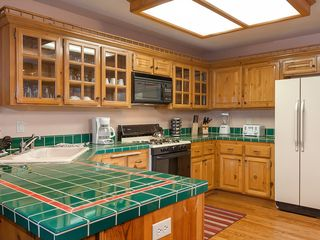 Bear Mountain cabin photo - Bright Kitchen with all appliances & kitchenware needed to stay in and cook.