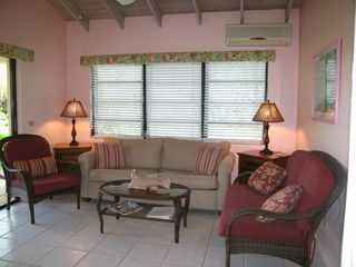 Spacious living area offers wi fi, cable TV, sofa bed, & wonderful sea views. - Spanish Wells villa vacation rental photo