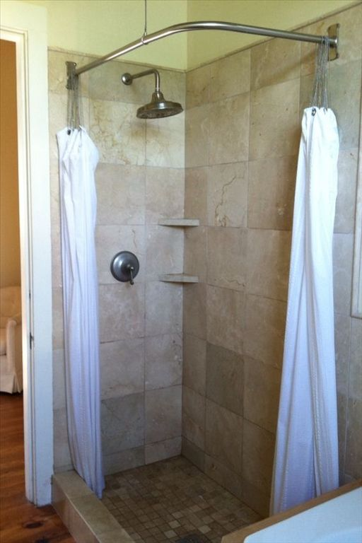 Marble shower in master bathroom with 2 person tub