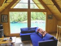 Riverfront cabin, own beach, hot tub over river, unsurpassed view, dog welcome