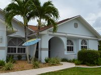South-facing villa near Cape Coral harbour with a large pool