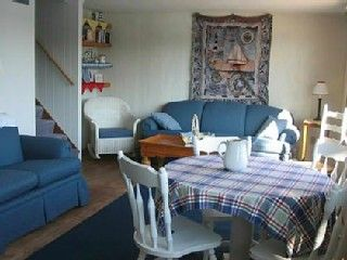 Traverse City house rental - The sunroom is great for morning coffee