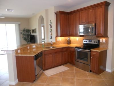 Granite counters, stainless steel appliances and 42' cabinets in kitchen