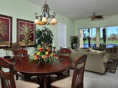 Dining room/living room. Gorgeous view of lake and golf course.