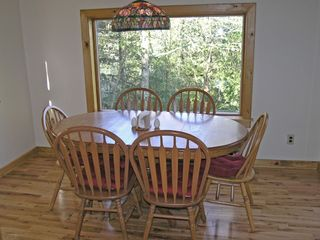 Dining room with view of water - Lake Placid house vacation rental photo