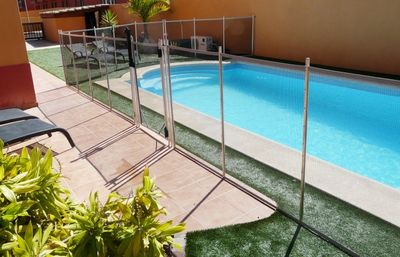 Corralejo villa rental - Pool shown with safety fence to protect kids