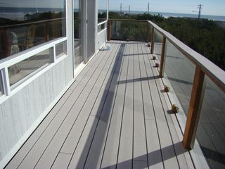 Waldport house photo - Large deck area with deck chairs stored downstairs