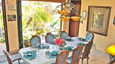 air conditoned dining room overlooks the water lilies and koi pond