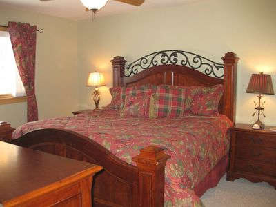 Beautifully decorated master bedroom with comfy king size bed