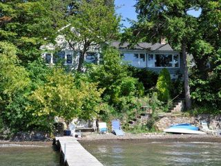 Waterfront view of cottage and 60' dock - Canandaigua cottage vacation rental photo