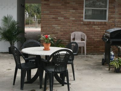 Outdoor living on the back patio...new gas grill, beautiful live oak trees!