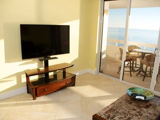 Redington Shores condo photo - Large TV with pivoting bracket in the living room.