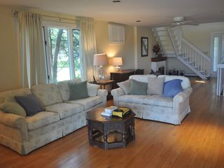 East Quogue house photo - View of living room, desk, and stairway that leads up to the bedrooms.