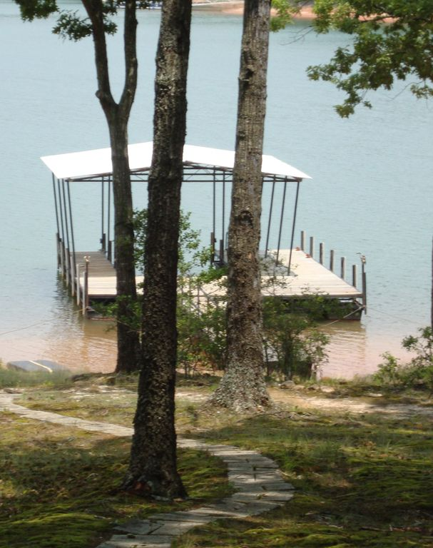 Single slip, sun platform. Swim/fish off dock. Boat ramp 5 min from house