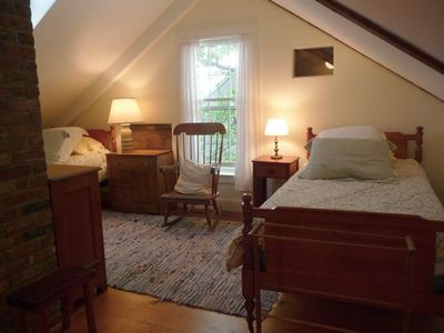 Third floor w/skylight, SE facing window, two twin beds and a roll-away bed